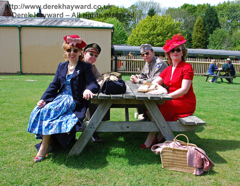 A smart wartime party taking a break at Kingscote. 10.05.2009