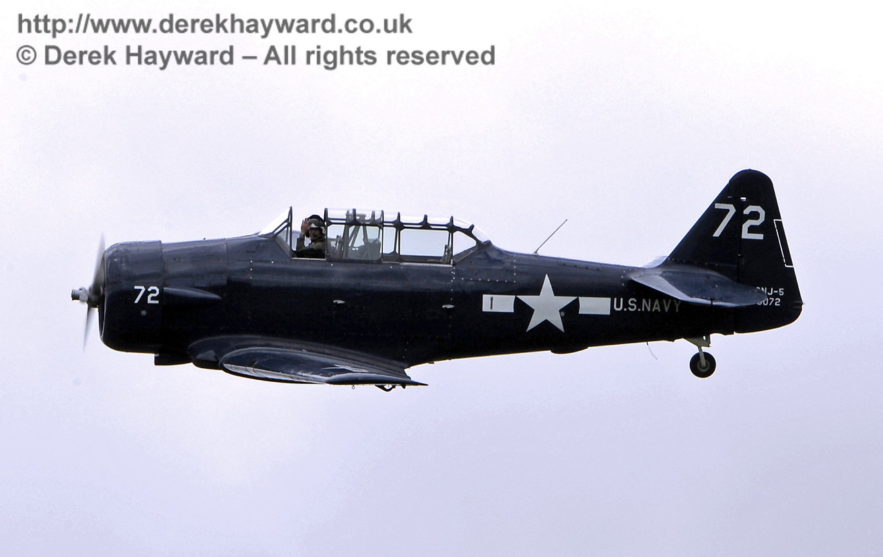 The US Navy T-6 Harvard pilot gives a wave at the end of his display. Southern at War, Horsted Keynes 11.05.2014  9212