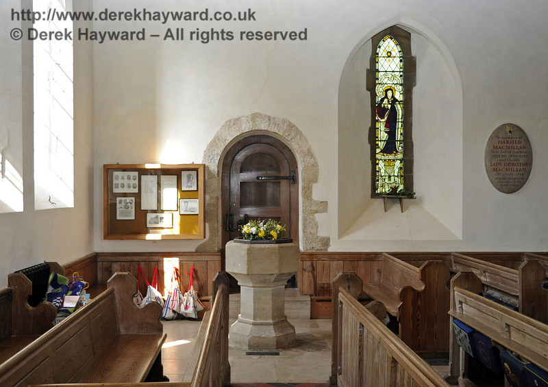 The Saxon door frame behind the font is the oldest feature of St Giles and was moved outwards when the north aisle was added in 1884 to accommodate the increased population of the village.  <br /> <br /> St Giles Church, Horsted Keynes 06.04.2013  6586