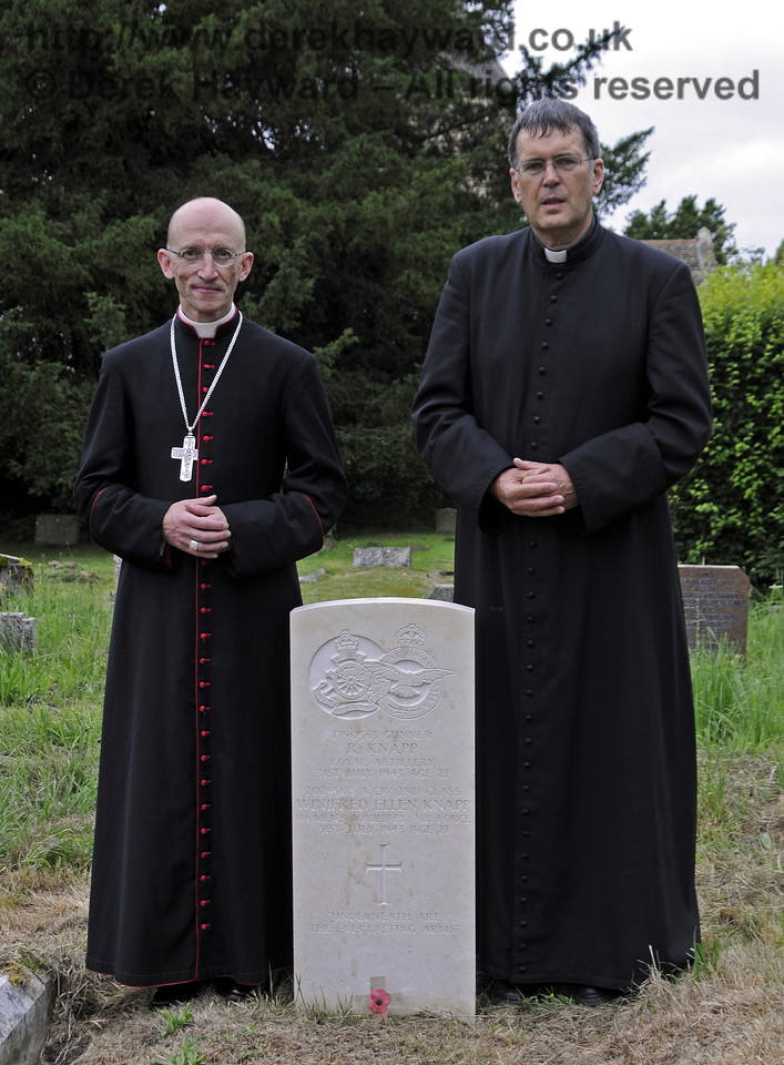 The Right Reverend Dr Martin Warner MA PhD, Bishop of Chichester and Canon John Twisleton (Father John), Rector of St Giles and Chaplain to the Bluebell Railway, at the Knapp grave after the ceremony to bless the stone.<br /> <br /> St Giles Church, Horsted Keynes 31.07.2013  9625