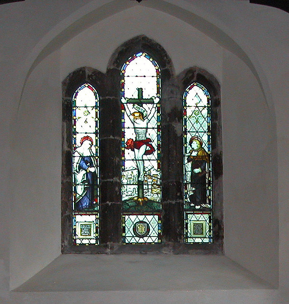 An earlier photo of the window behind the high altar seen in the previous picture.  <br /> <br /> St Giles Church, Horsted Keynes.  09.04.2004