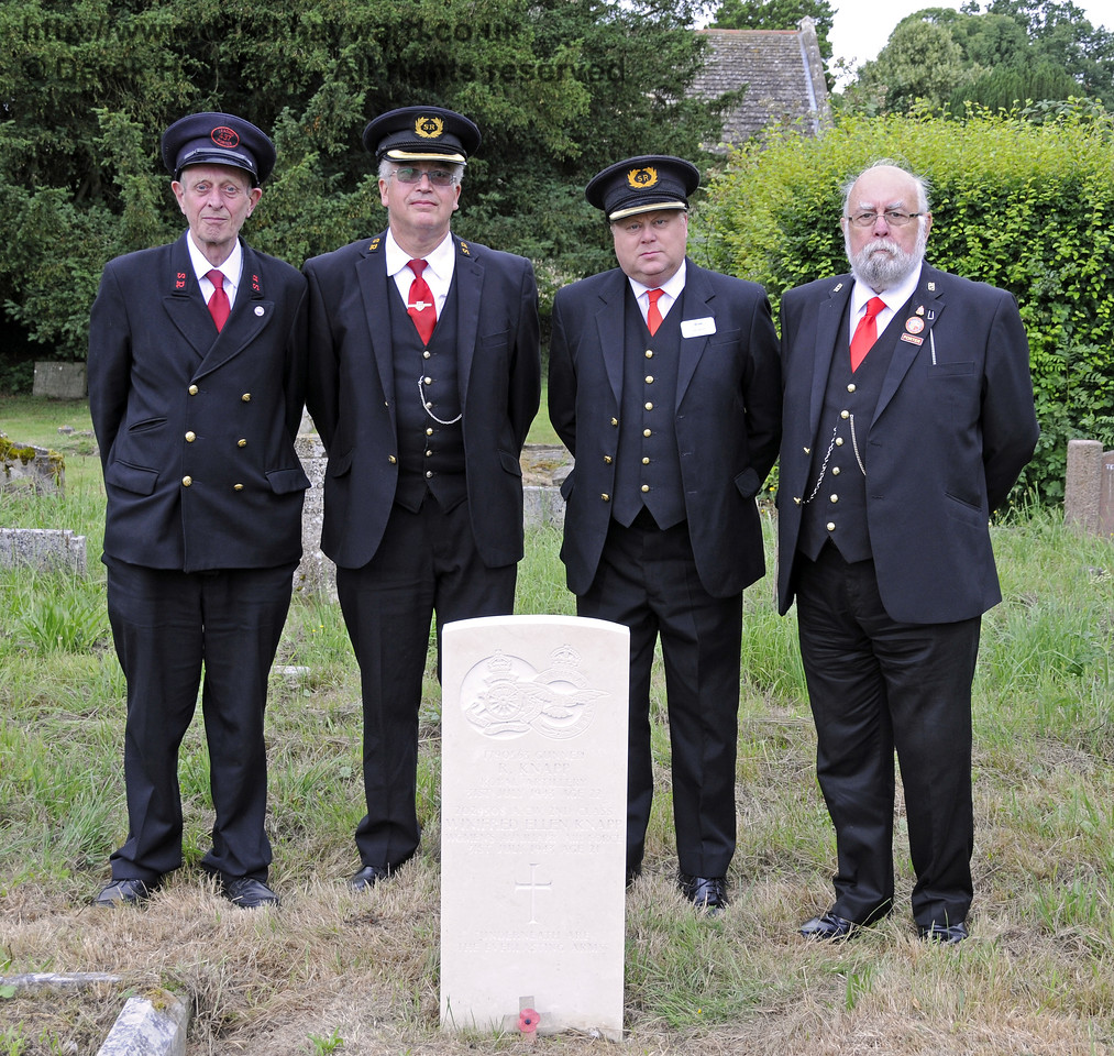 Tim Baker, Commercial Director, Bluebell Railway, at the Knapp grave with John Hotston. Ian Fribbens and Geoff Peters, representing the railway.  Other BRPS members, not in uniform, also attended the ceremony.<br /> <br /> St Giles Church, Horsted Keynes 31.07.2013  9612