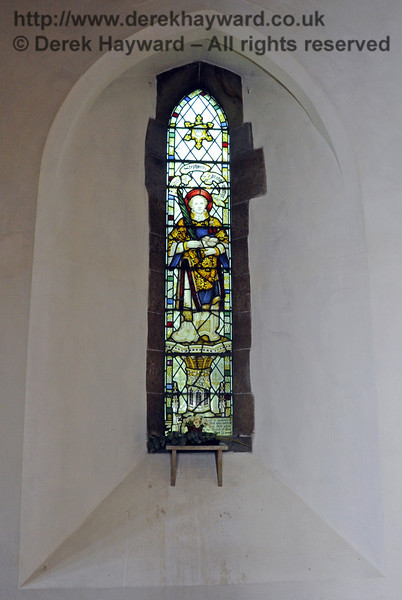 The Kemp window of St Stephen honours Sidney Peek (1889 - 1910), a teacher at St Giles School, who served as a highly resourceful missionary in what is now Malawi and died of black water fever aged 21.  <br /> <br /> St Giles Church, Horsted Keynes 06.04.2013  6625