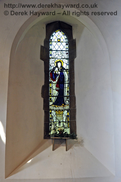 The window of St Monica to the right of the font recalls St Monica's home for sick and incurable children founded in 1874 in Kilburn by Lucy Forster and Katherine Marshall here commended.  <br /> <br /> St Giles Church, Horsted Keynes  06.04.2013  6621