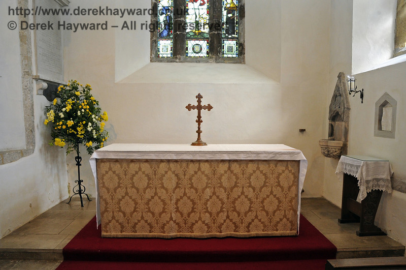 The high altar in St Giles Church, Horsted Keynes.  To the right the everlasting light burns before the Blessed Sacrament Aumbry (2003) containing consecrated Bread reserved from the Eucharist.  At this place especially people kneel and pray. 06.04.2013  6639