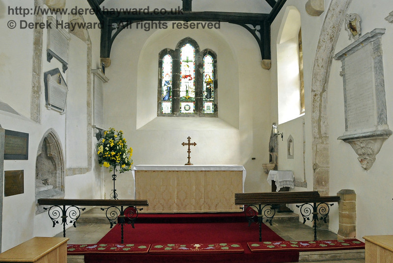 The area of the high altar in St Giles Church, Horsted Keynes. Behind the altar light is flooding through a Crucifixion window by 19th Century local stained glass artist Charles Kempe.   06.04.2013  6635