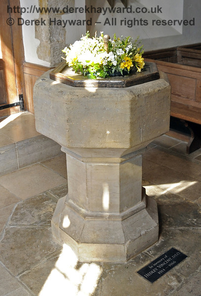 "The octagonal font is 14th century and was moved to it's current position by the originally Saxon doorway in 1904.  The plate on the floor reads ""In memory of Hedley Vincent, DSO, 1914 - 1966"".  <br /> <br /> St Giles Church, Horsted Keynes 06.04.2013  6620"