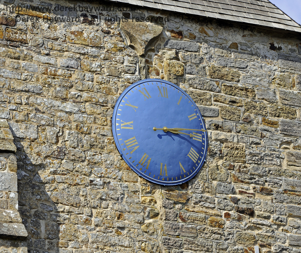 The mechanical clock, made in 1854, on the tower of St Giles Church, Horsted Keynes.  Electrical winding and a chiming mechanism have been added subsequently.  There is a motor on the pendulum so that each hour the clock is checked by radio and the length of the pendulum altered as necessary.  06.04.2013  8640