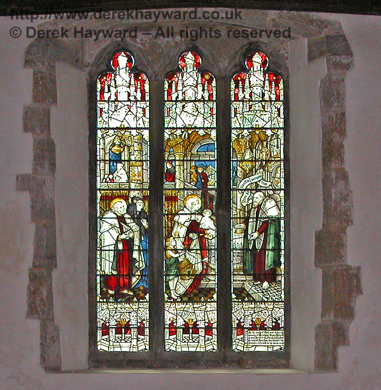 An earlier image of the same window, with slightly less external glare, shows the detail of the window more clearly.<br /> <br /> St Giles Church, Horsted Keynes 09.04.2004