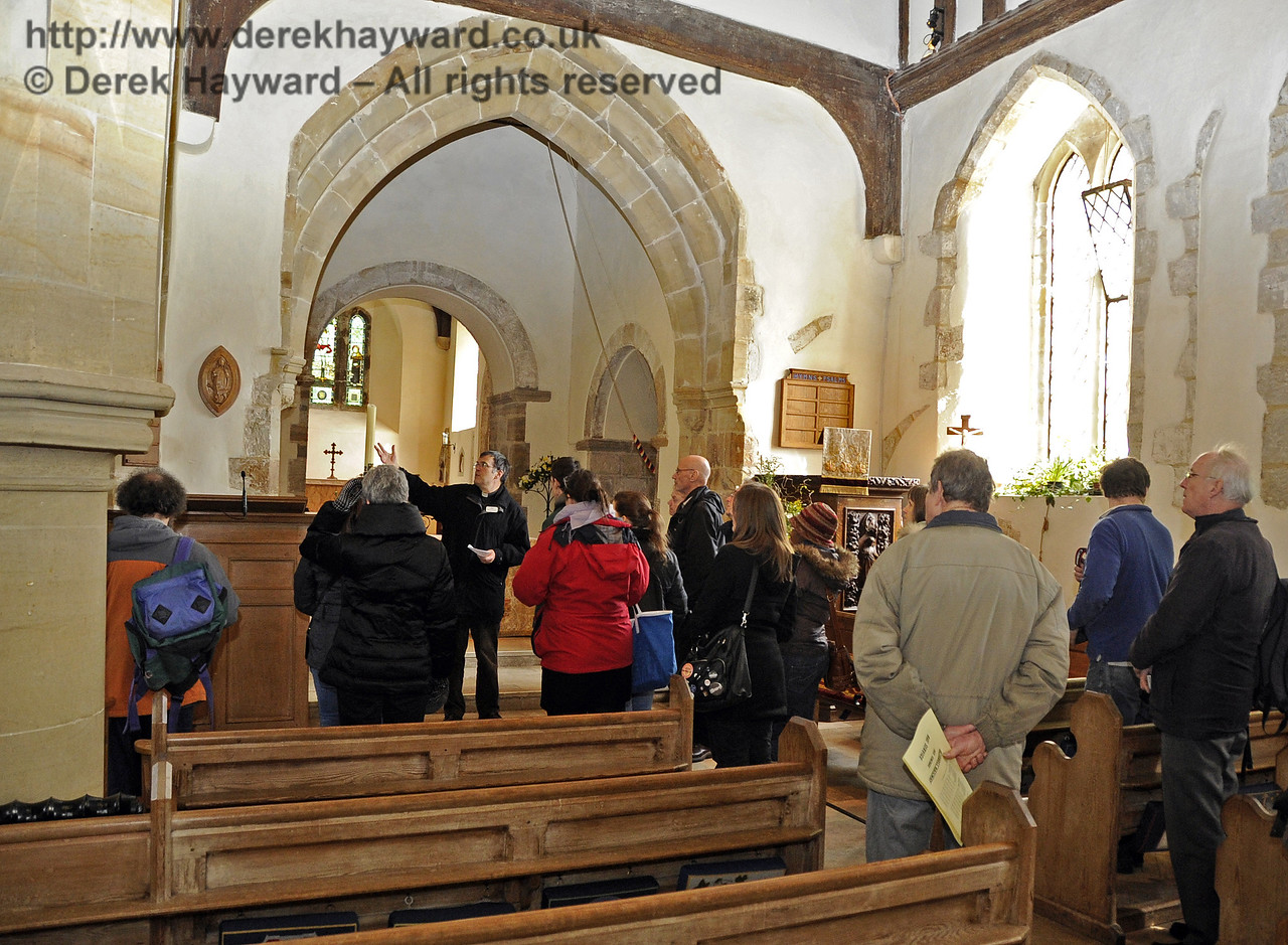 A tour of St Giles Church, Horsted Keynes, organised by the Bluebell Railway, being conducted by the Rector.  06.04.2013  6590