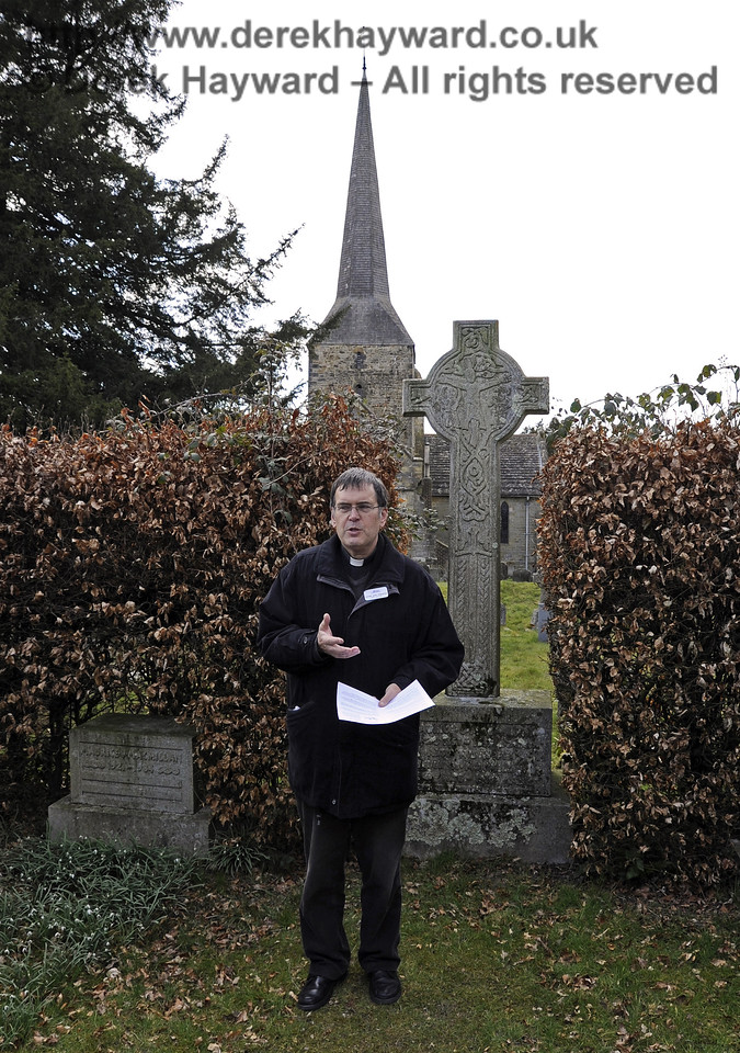 The Rector at the Macmillan Family Plot, St Giles Church, Horsted Keynes.  06.04.2013  6596