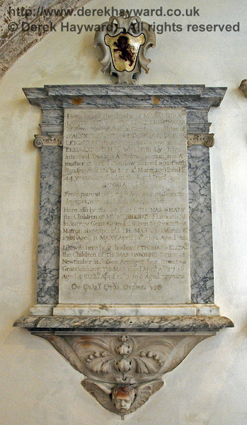 "This memorial near the high altar has an inscription which is worn and in places difficult to read.  It is believed to say:<br /> <br />  ""Here lyeth the body of Mrs Sarmira Lightmaker, wife of Mr Edward Lightmaker of Broadhurst in Sussex, Gentleman.  Daughter of Dr Alexander Leighton DD, Sister to Dr Robert Leighton, late Archbishop of Glasgow, and Sir Ellis Leighton, Knight, who both lie here interred.  She was a devout woman and a Mother in [unclear] a widow indeed and (notwithstanding [unclear] to a 2nd marriage) lived for 44 years.  She died in the Lord December 20th 1704 aged 81. <br /> <br /> [Latin inscription not transcribed]<br /> <br /> Here also lie the bodies of Thomas and Mary the Children of Mr William [unclear] of Limesfield in Surrey, Gentleman.  Grandchildren to ye excellent Matron above specified.  Thomas died March 8th 1701 aged 11, Mary [died] April 10th 1702 aged 21.<br /> Likewise here lie ye bodies of Thomas and Elizabeth, the Children of Thomas Osborne Junior of Newtimber in Sussex Armiger. Her Great Grandchildren, Thomas died April 4th 1706 aged 4, Elizabeth [died] April 12th 1706 aged 3 years<br /> <br /> [Latin inscription not transcribed]""<br /> <br /> St Giles Church, Horsted Keynes 06.04.2013  6649"