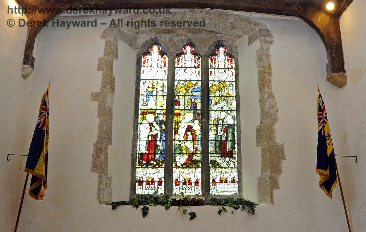 "The stained glass commemorative window at the western end of the main aisle in St Giles Church, Horsted Keynes.<br /> ""To the Glory of God and in loving memory of Christopher Rodwell, Rector of this Parish...."" 06.04.2013  6657"