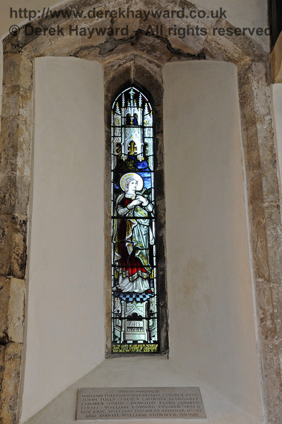 "A memorial window ""To the Glory of God and in memory of John Tully Comber of Cockhaise who died November 19th 1892, aged 57.""  <br /> <br /> A stone plaque below the window is inscribed ""also in memory of William Tully (died 1945) and Emma Comber (1935), John Tully (1949) and Laurina Margaret Comber (1940); Dorothy Ellen Comber (1931); William Edward Comber (1943); and Eric William Douglas Skinner (1931); also David William Skinner (1990).  <br /> <br /> St Giles Church, Horsted Keynes 06.04.2013  6644"