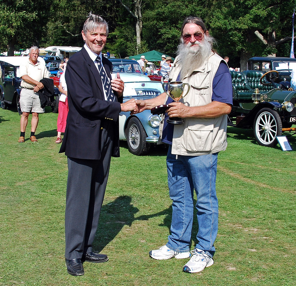 Bill Brophy (Chairman of the Bluebell Railway Trust), presents the Bluebell Cup for best Motorbike to Stephen Elston. Horsted Keynes 16.08.2009
