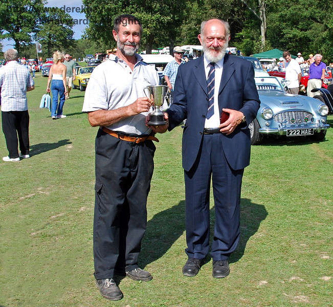 Derek Carter received the London Area Cup for best Stationary Engine from Dave Philips (Bluebell Railway). Horsted Keynes 16.08.2009