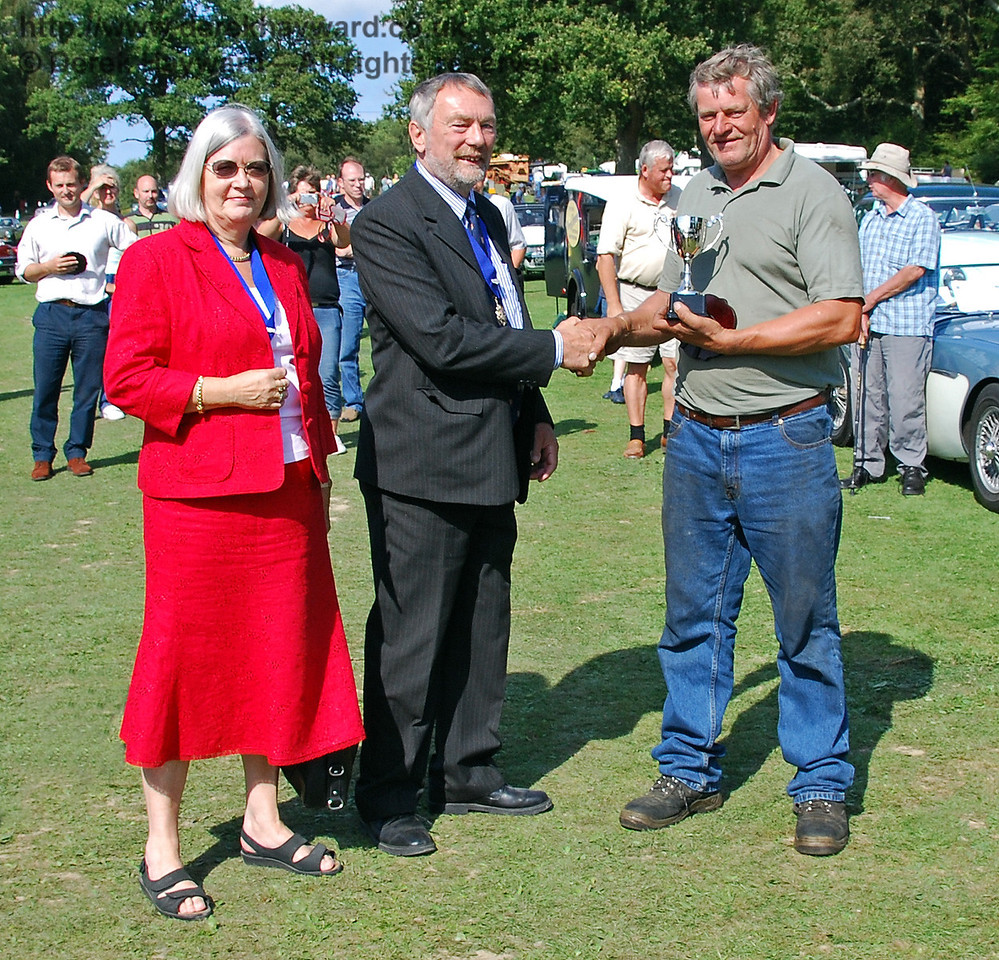 Anne Turner (Deputy Mayoress of Lewes) and Councillor Dr Michael Turner (Deputy Mayor of Lewes) present the Lewes Cup for best Tractor or Farm Machinery to Clive Furminger for his Lister (pictured earlier). Horsted Keynes 16.08.2009