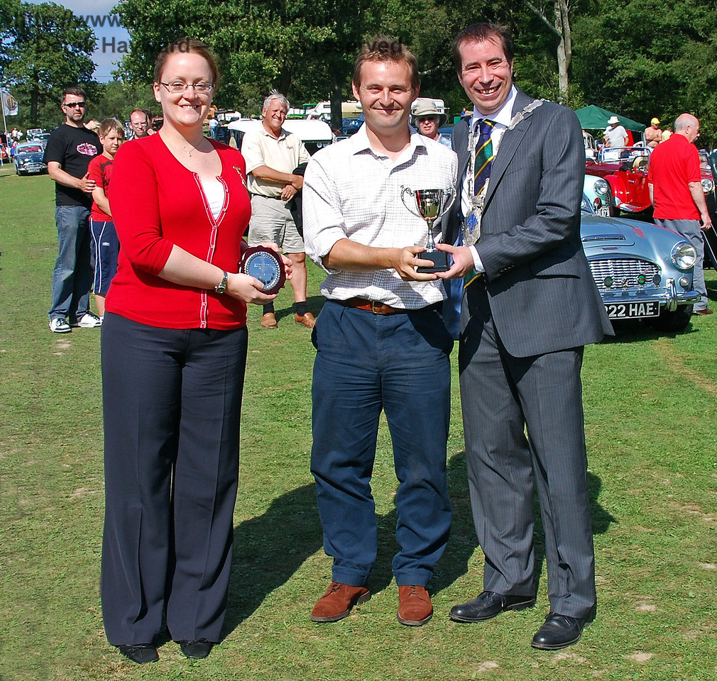 Councillor Lee Marmara (Mayor of East Grinstead) and the Mayoress, Emma Marmara, present the Grinstead Cup to Nicholas Bentley for the best Classic and Vintage Car, an Aston Martin DB6. Horsted Keynes 16.08.2009