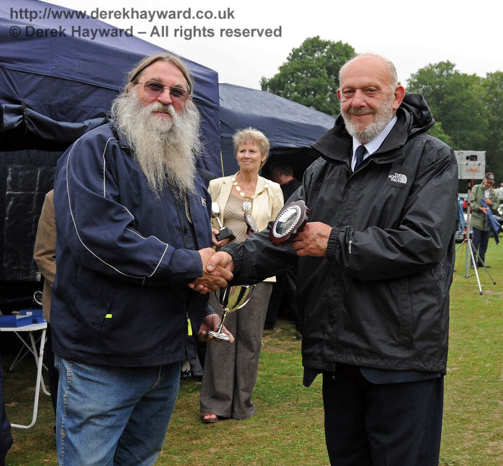 Stephen Elston receives the Bluebell Cup for best Motor Cycle from Dave Philips (Bluebell Railway). Horsted Keynes 22.08.2010  4345