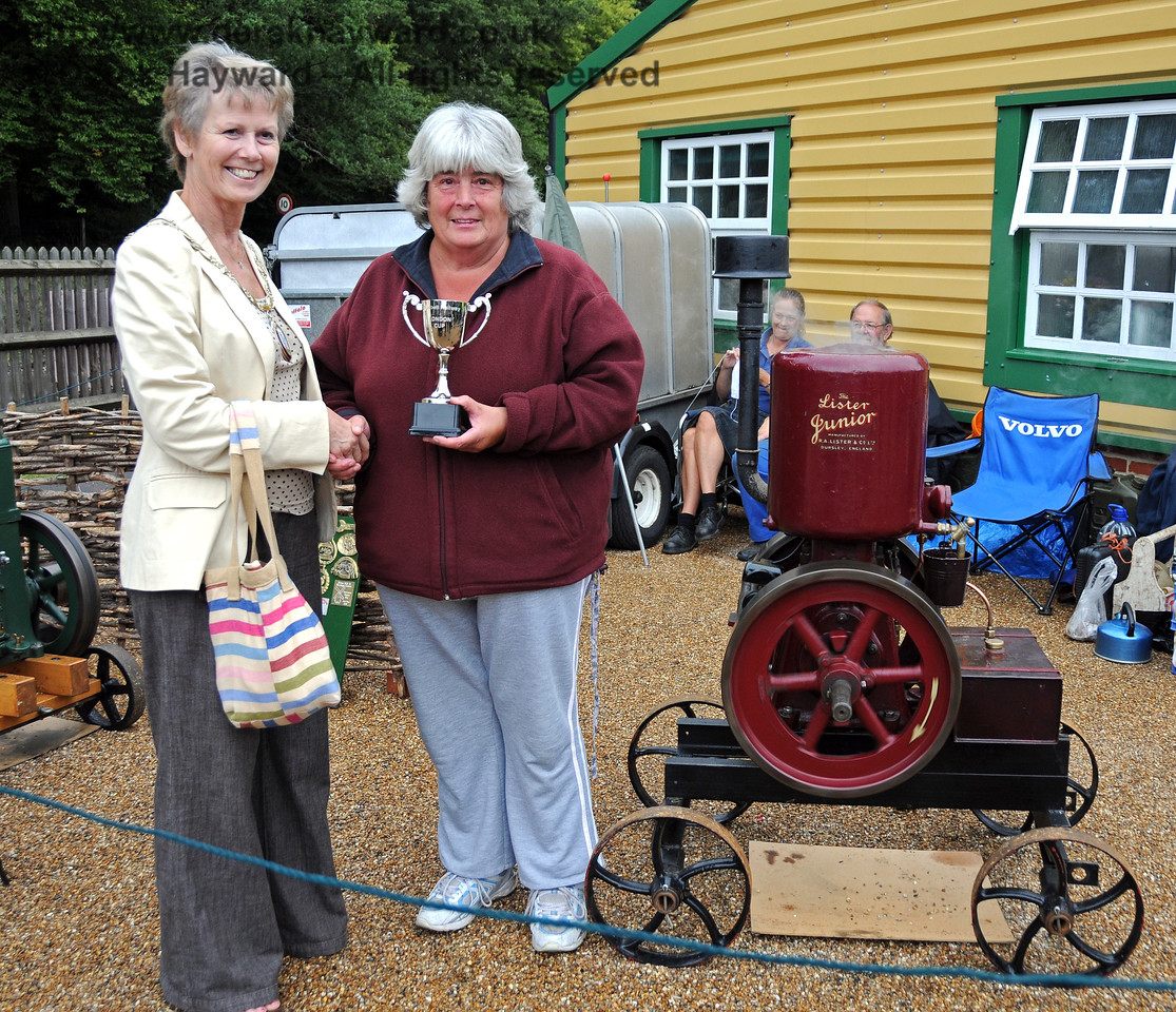 Christine Jones received the London Cup for best Stationary Engine for her 1930 Lister Junior.  The award was presented by Councillor Margaret Baker (Mayor of Haywards Heath). A very surprised Christine said that she had never won anything in her life! Horsted Keynes 22.08.2010  4368