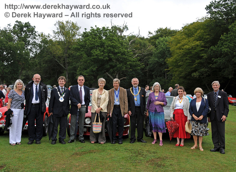 A long line of judges (each with one vote) pose in front of some of the vehicles. Val Wall (Bluebell Railway), Dave Philips (Bluebell Railway), Councillor Steve Barnett (Mayor of East Grinstead), David Rossiter (Stagecoach Buses), Councillor Margaret Baker (Mayor of Haywards Heath) and her husband, Councillor Dr Michael Turner (Mayor of Lewes), Anne Turner (Mayoress of Lewes), Pauline Barnett (Mayoress of East Grinstead), Janet Rossiter (Stagecoach) and Bill Brophy (Vice President BRPS). Horsted Keynes 22.08.2010  4322