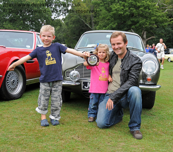 Nicholas Bentley poses with his children in front of the winning car. Horsted Keynes 22.08.2010  4363
