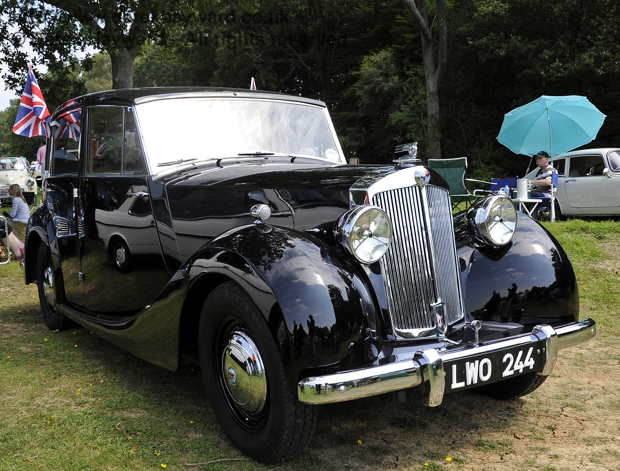Jim Shotter won the Bluebell Cup for the best post-war motor car, with his 1953 Triumph Renown, LWO244.  The judges commended the excellent presentation of the vehicle.  Bluebell Railway Vintage Transport Weekend, Horsted Keynes, 12.08.2012  5509