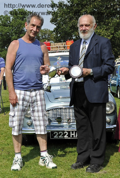 Jim Shotter won the Bluebell Cup for the best post-war motor car, with his 1953 Triumph Renown, LWO244.  The judges commended the excellent presentation of the vehicle.  Bluebell Railway Vintage Transport Weekend, Horsted Keynes, 12.08.2012  5605