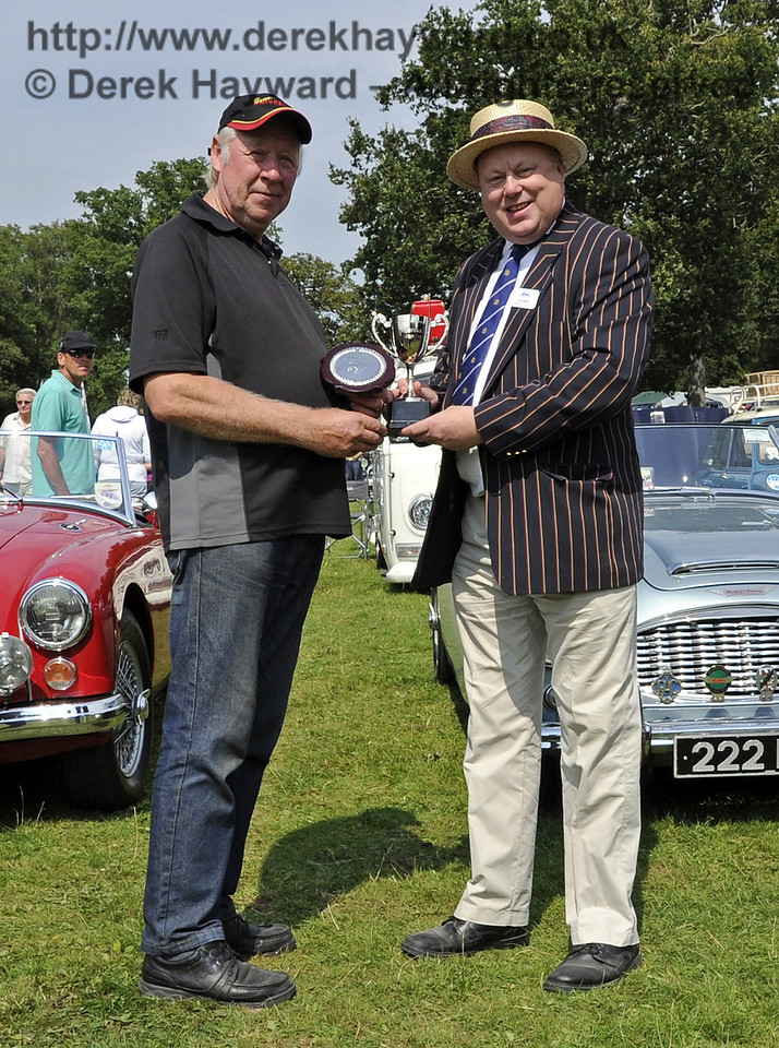 Bryan Sharp won the award for best Stationary Engine with his 1948 Wolseley WDII water pump.  Bluebell Railway Vintage Transport Weekend, Horsted Keynes, 12.08.2012  5581