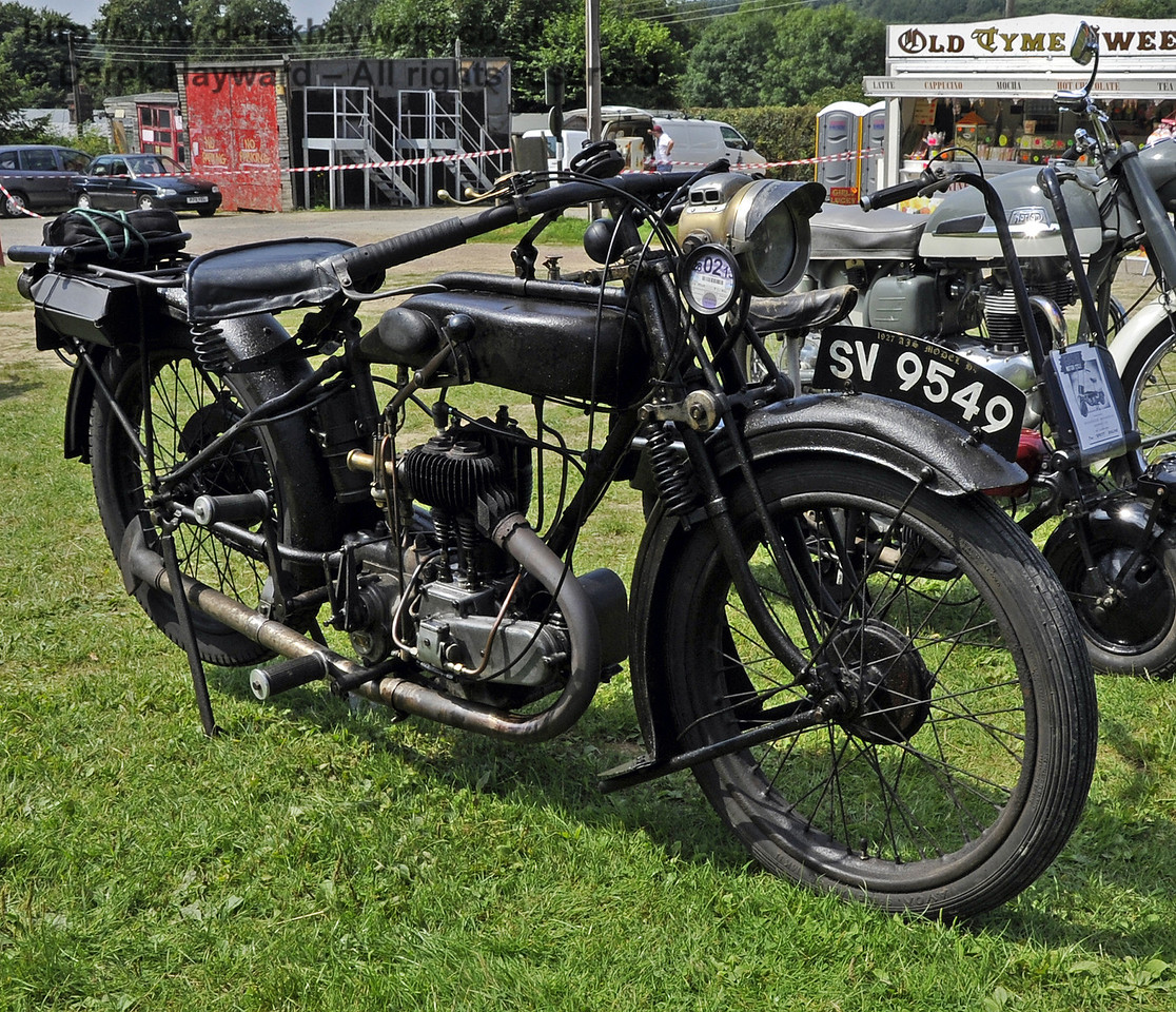 Peter Gibson won the award for best pre-1938 motor cycle with his AJS H4 350SV, SV9549.  The judges noted that it was a fine example in original condition.  Bluebell Railway Vintage Transport Weekend, Horsted Keynes, 12.08.2012  5500