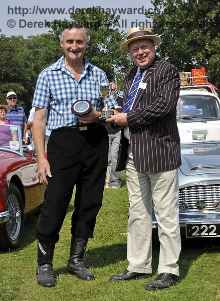 Geoffrey Naughton won the award for best post-1938 motor cycle with his Douglas Dragonfly, SCD218.  The judges were much impressed with the condition of the bike.  Bluebell Railway Vintage Transport Weekend, Horsted Keynes, 12.08.2012  5591