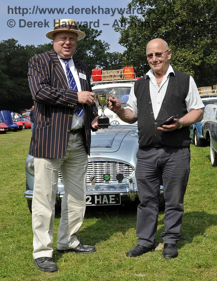 Timothy Stables received the Lewes Cup for best Commercial Vehicle, with his 1947 Fordson E83W, PUJ122.  The judges felt that Mr Stables had displayed his vehicle to a very high standard.  Bluebell Railway Vintage Transport Weekend, Horsted Keynes, 12.08.2012  5640