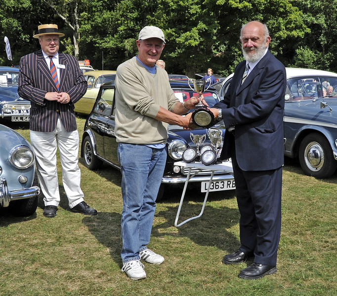 The Grinstead Cup for best post war car was awarded to Peter Goodall for his 1962 Vauxhall Cresta EOO492.  Vintage Transport Weekend, Horsted Keynes, 11.08.2013  7851