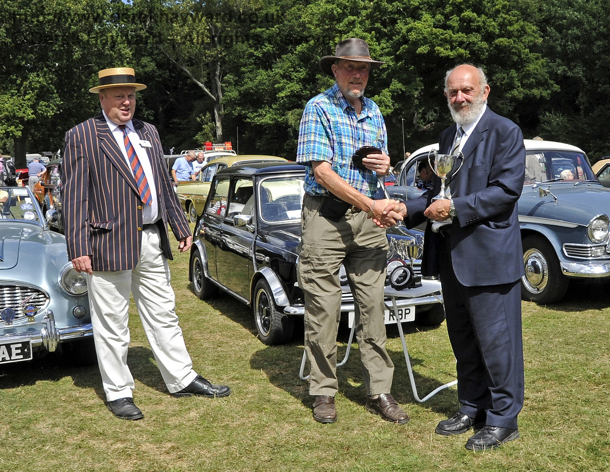 The Southdown Cup for Best in Show was awarded to Steven Green for his Mini Rio, L363RBP.  Vintage Transport Weekend, Horsted Keynes, 11.08.2013  7859