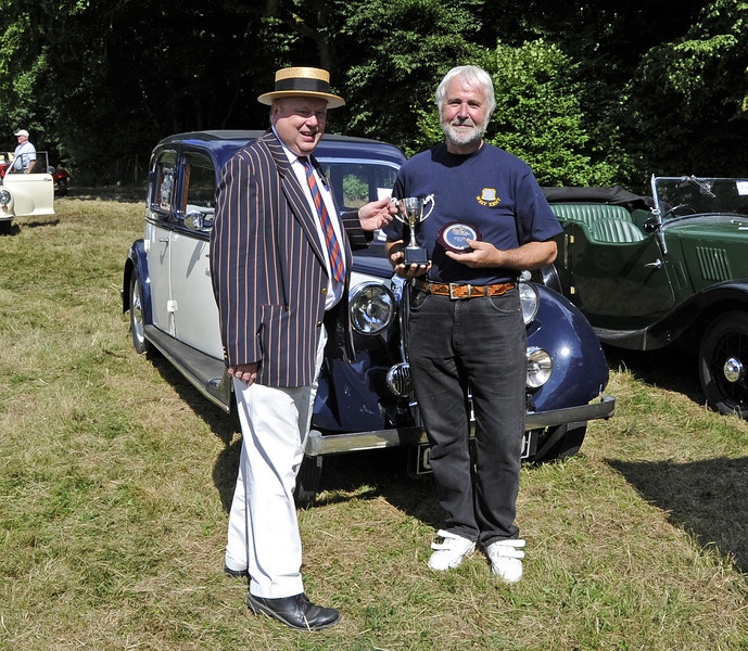 The Brighton Cup for best pre-war car was awarded to Jeff Rawlings for his P2 Rover, CDD730.  Vintage Transport Weekend, Horsted Keynes, 11.08.2013  7910