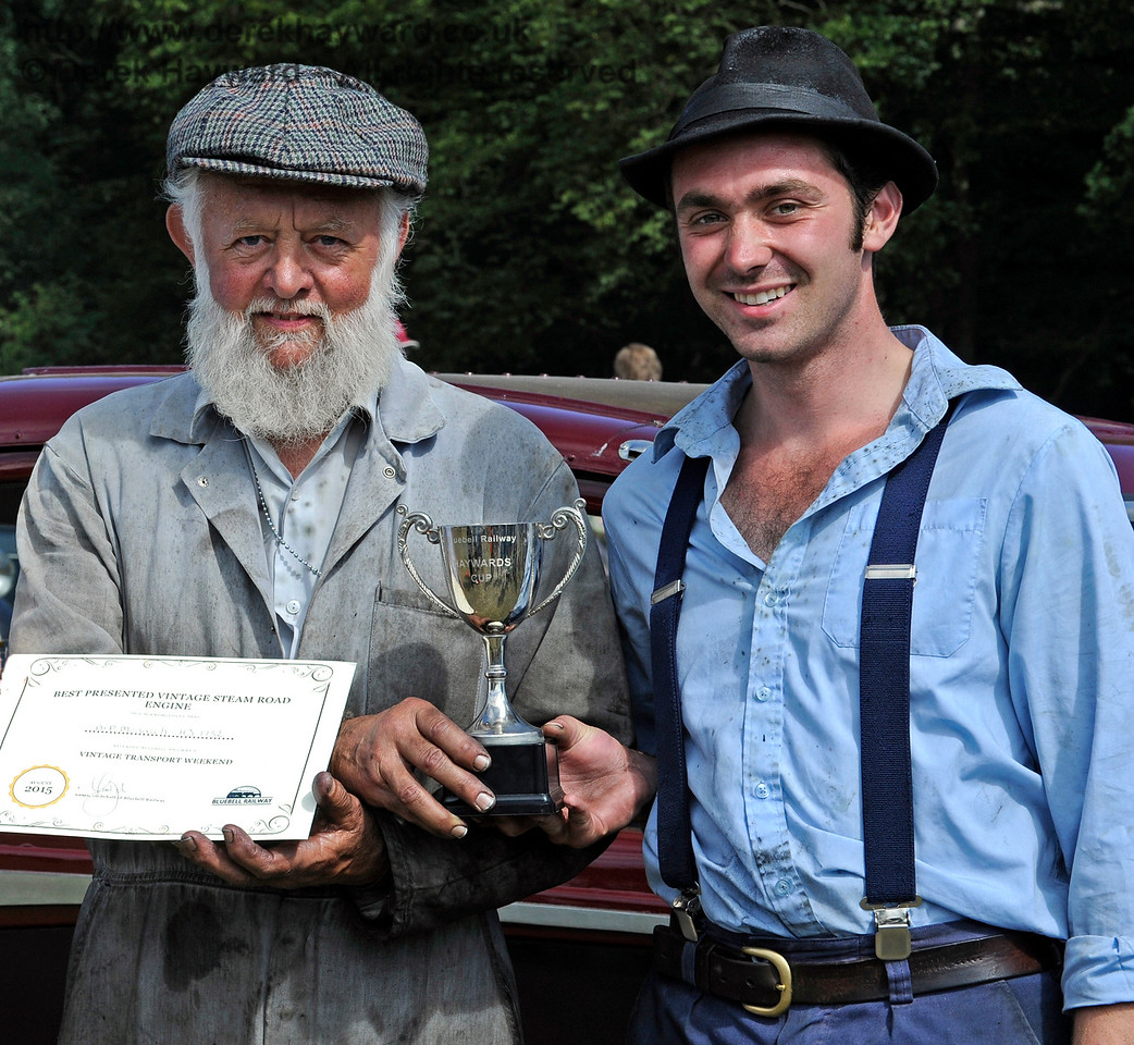 The award for Best Steam Road Engine went to the AP Monach, HJ1732.  Receiving their award are Roy Miles (left) and Oliver Warburton (right).  Vintage Transport Weekend, Horsted Keynes.  09.08.2015   11868
