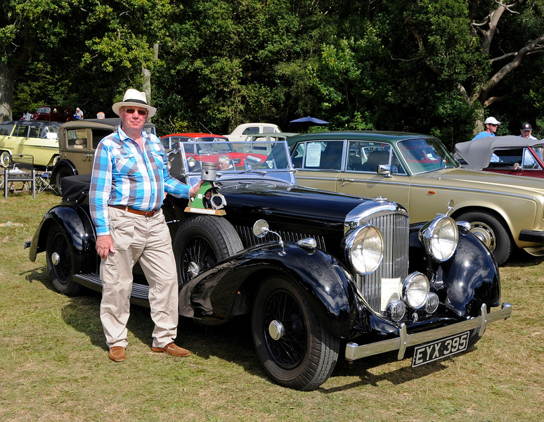 Best in Show winner Mike Ryan poses with his Bentley 4 1/4 Overdrive, EYX395.  Vintage Transport Weekend, Horsted Keynes.  09.08.2015   13683