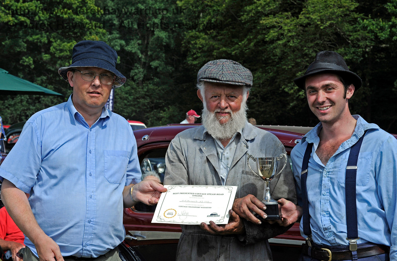 The award for Best Steam Road Engine went to the AP Monach, HJ1732.  Receiving their award are Roy Miles (centre) and Oliver Warburton (right).  Vintage Transport Weekend, Horsted Keynes.  09.08.2015   11866
