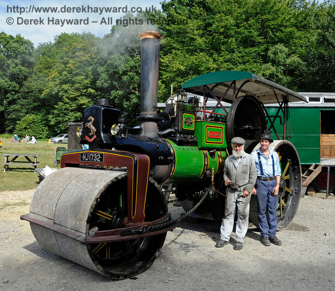 The award for Best Steam Road Engine went to the AP Monach, HJ1732.  Posing with their engine are Roy Miles (left) and Oliver Warburton (right).  Vintage Transport Weekend, Horsted Keynes.  09.08.2015   13688