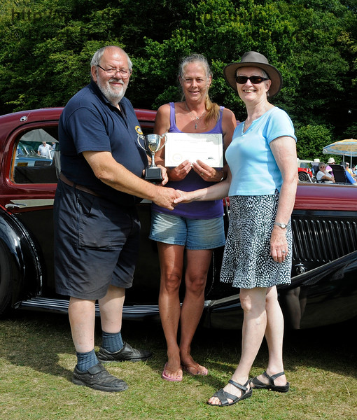 The award for best Stationary Engine went to Alan Cullen for his Ruston Hornsby, with Butter Churn.  Alan is seen with his wife (centre) receiving their award.  Vintage Transport Weekend, Horsted Keynes.  09.08.2015  13660