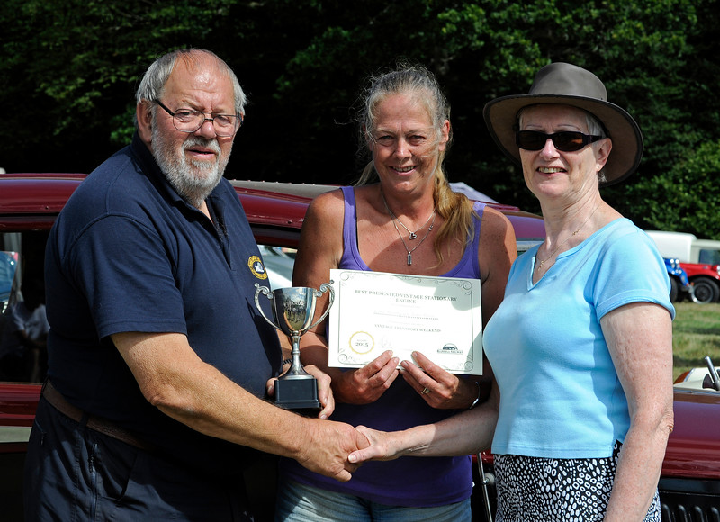 The award for best Stationary Engine went to Alan Cullen for his Ruston Hornsby, with Butter Churn.  Alan is seen with his wife (centre) receiving their award.  Vintage Transport Weekend, Horsted Keynes.  09.08.2015  11872
