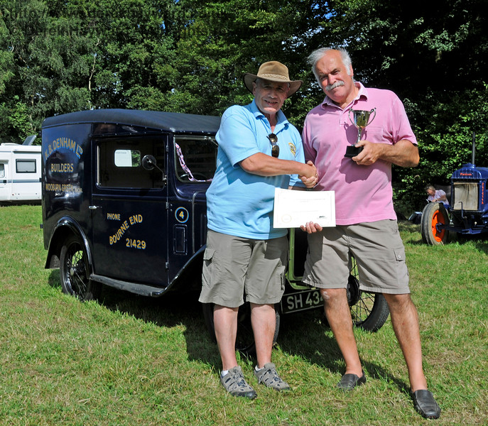 The award for Best Commercial Vehicle went to a Denhams Austin Van, SH4344, owned by Jeremy and Sue Thorpe.  Jeremy is seen (right) receiving his award.  Vintage Transport Weekend, Horsted Keynes.  09.08.2015  13692