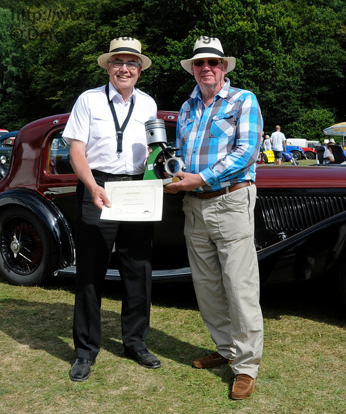 Clive Kessell presented the Southdown Trophy for Best in Show to Mike Ryan for his Bentley 4 1/4 Overdrive, EYX395.  Vintage Transport Weekend, Horsted Keynes.  09.08.2015   13667