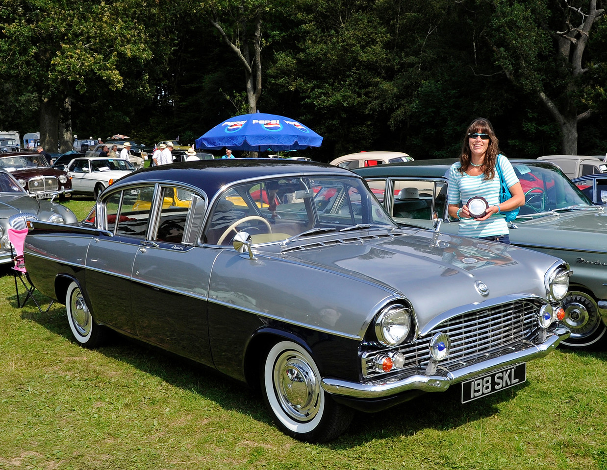 Karen Bush, the owner of the 1962 Vauxhall Cresta, 198SKL, was unfortunately unavailable to be photographed in 2015.  She is seen here in 2012 when her car won the Southdown Cup for Best in Show.  The independent judges who examined the vehicles in 2015 were unaware of her previous success.  12.08.2012  5630