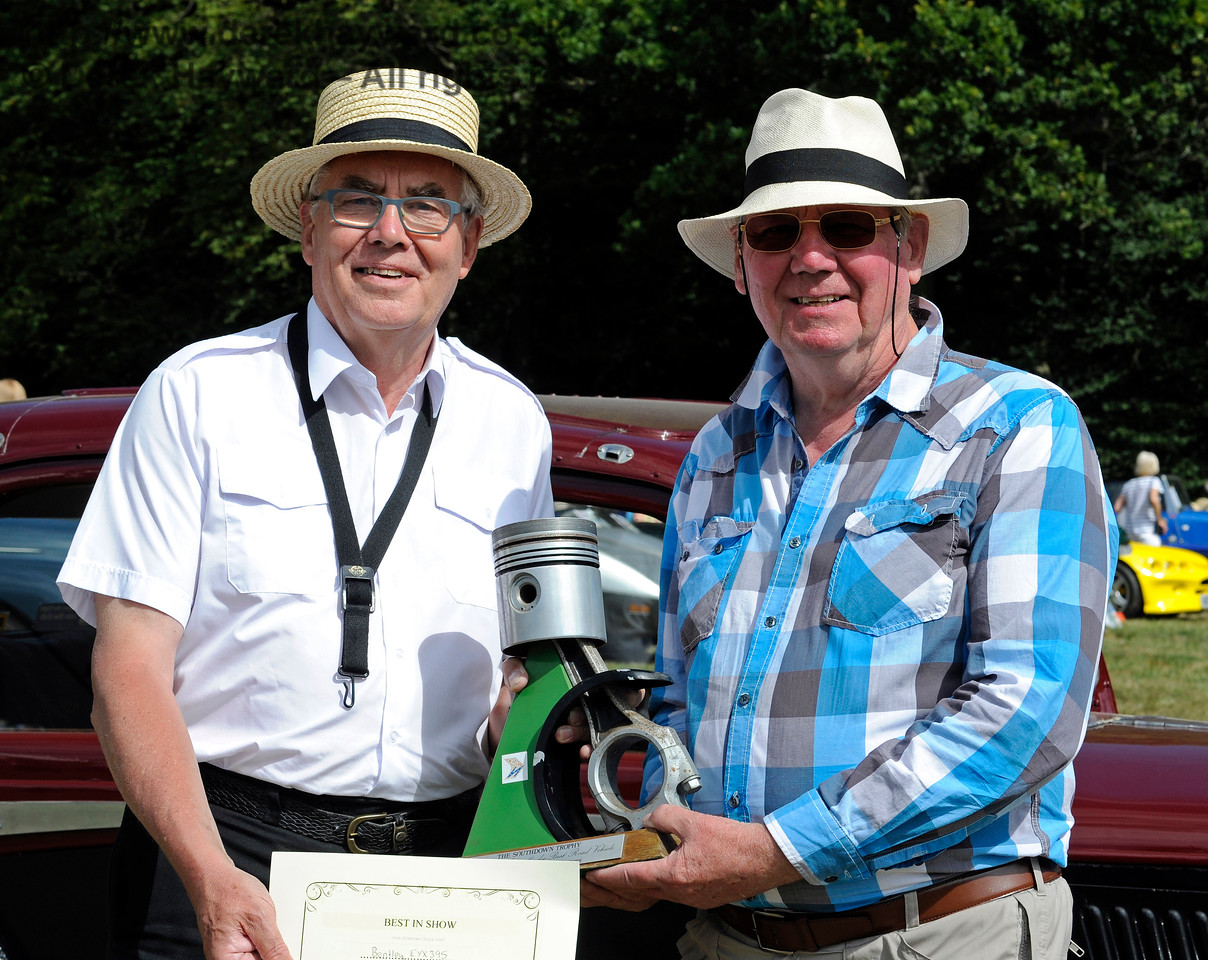 Clive Kessell presented the Southdown Trophy for Best in Show to Mike Ryan for his Bentley 4 1/4 Overdrive, EYX395.  Vintage Transport Weekend, Horsted Keynes.  09.08.2015   11876
