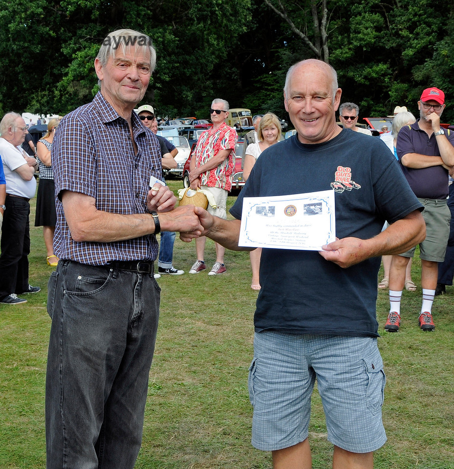 Highly Commended in the Cars was a GT6 Mk3 GTJ102K owned by Ian and Christine Gordon.  Ian is seen here collecting his certificate from Bill Brophy.  Vintage Transport Weekend, Horsted Keynes, 14.08.2016  16237