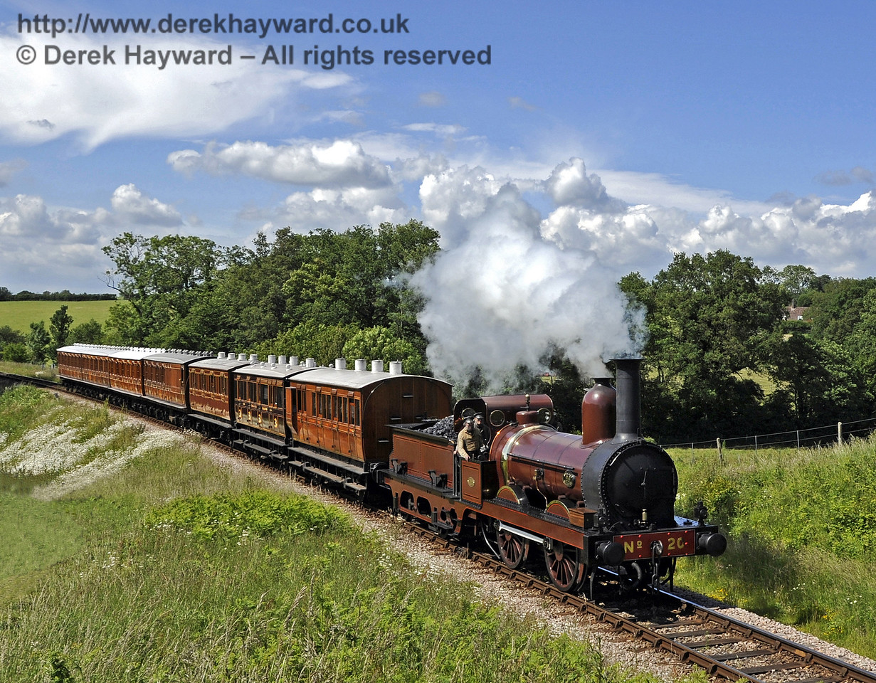 Furness Railway No.20 approaches Rock Cutting with the empty stock from a private filming charter.  19.06.2012  5187