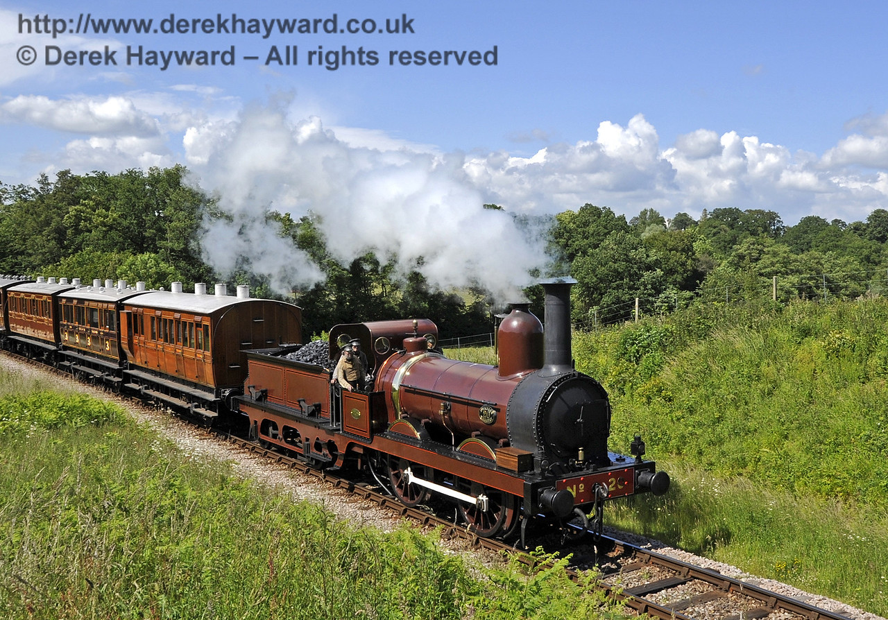Furness Railway No.20 steams through Rock Cutting with the empty stock from a private filming charter.  19.06.2012  5188