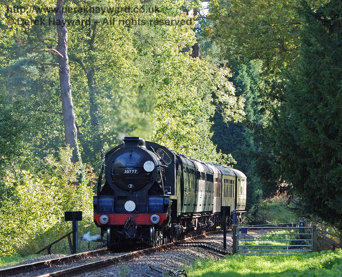 30777 Sir Lamiel passes over Birch Farm foot crossing..  22.10.2010 30009