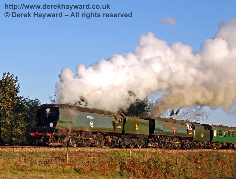 34081 92 Squadron and 34007 Wadebridge leave Sheffield Park as the sun goes down. 20.10.2007